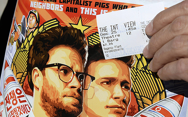 "A ticket and a poster of the film ""The Interview"" starring actors Seth Rogen and James Franco in December 25, 2014. ""The Interview,"" the Sony Pictures film about a fictional plot to assassinate North Korean leader Kim Jong Un, opened in more than 300 movie theaters across the United States on Christmas Day, drawing many sell-out audiences and statements by patrons that they were championing freedom of expression. REUTERS/Kevork Djansezian"