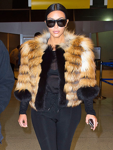 Kim Kardashian in cropped furry jacket in the airport