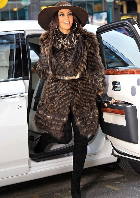 Kim Kardashian wearing a brown fur coat