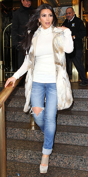 Kim Kardashian wears a fur topper