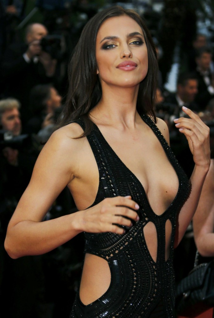 """Russian model Irina Shayk poses on the red carpet as she arrives for the screening of the film """"All is Lost"""" during the 66th Cannes Film Festival in Cannes on May 22, 2013."""