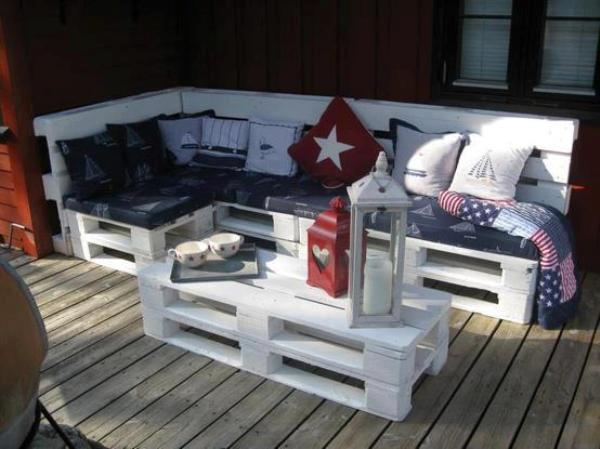 sofa bed and coffee table made from wooden pallets