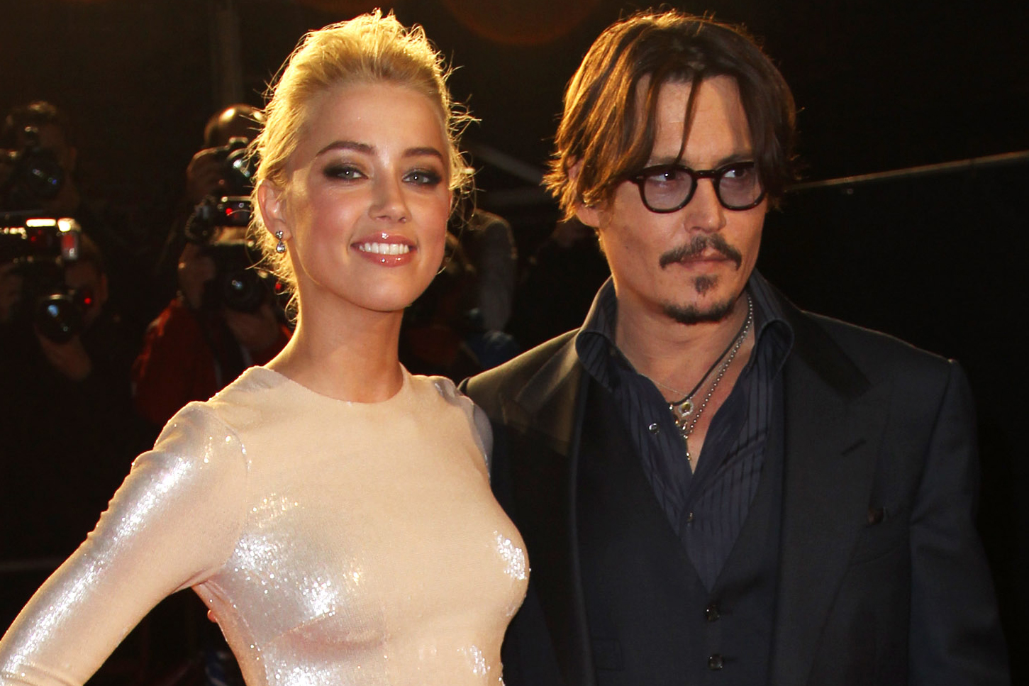 LONDON, ENGLAND - NOVEMBER 03:  (UK TABLOID NEWSPAPERS OUT) Johnny Depp and Amber Heard attend the European premiere of 'The Rum Diary' at The Odeon Kensington on November 3, 2011 in London, England.