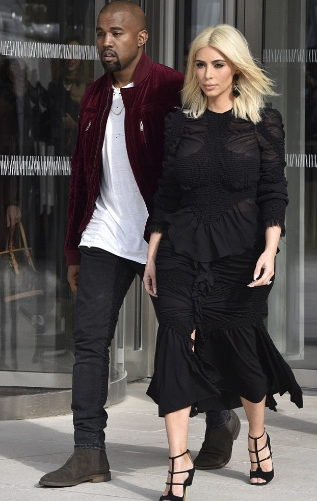 Kim K's improvements are hard to ignore; here heading with Kanye West to another fashion show in Paris