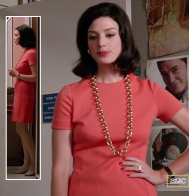 Megan Draper in a coral dress in Mad Men