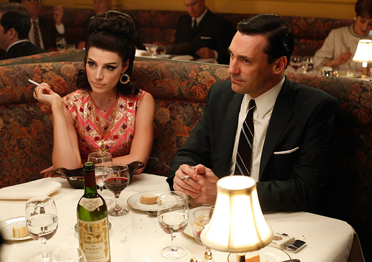Megan Draper wearing a pink cocktail dress in Mad Men