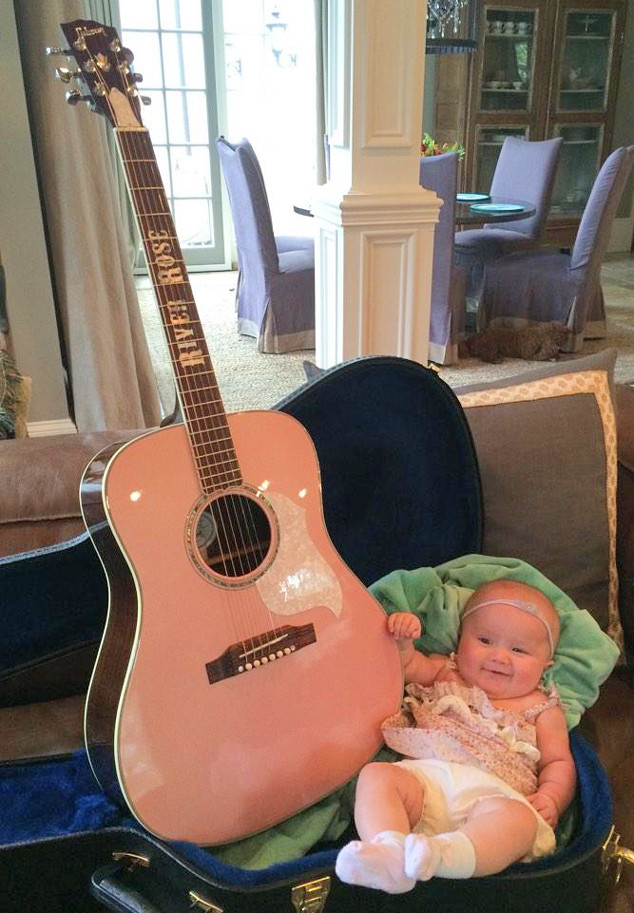 River Rose playing the guitar