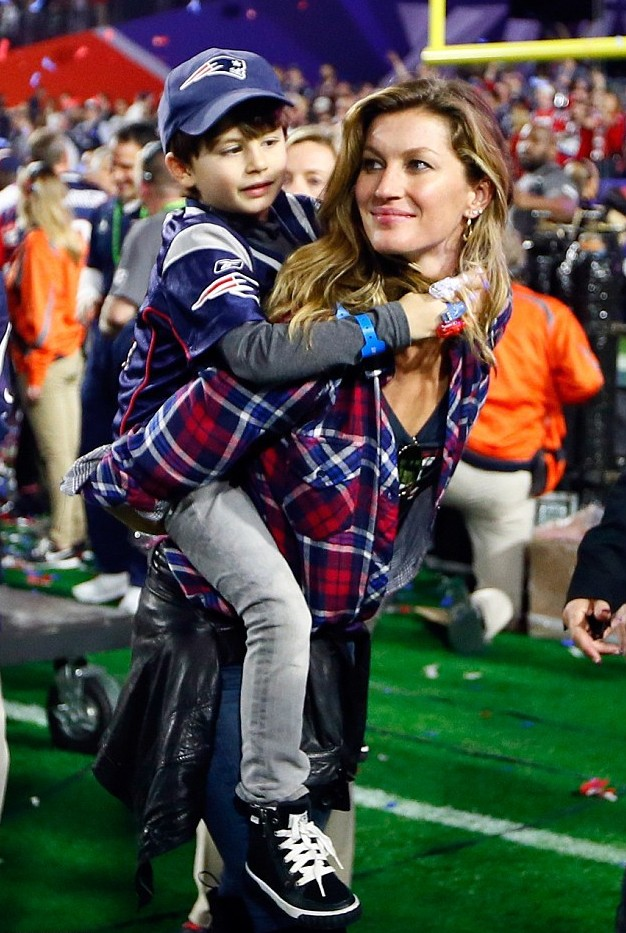 Gisele Bundchen and her five year old son Benjamin supporting Tom Brady
