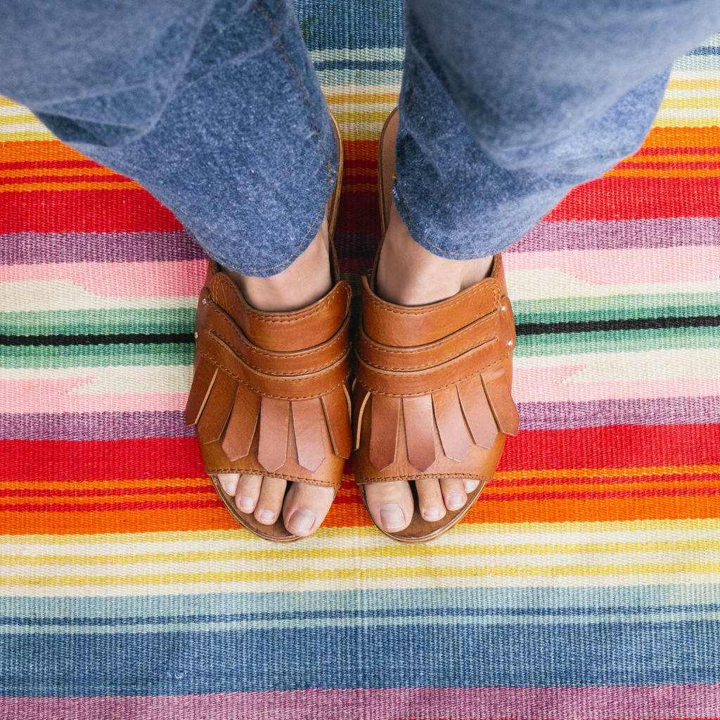 These are very Carrie. Casadei open toe fringed clog sandals, $675