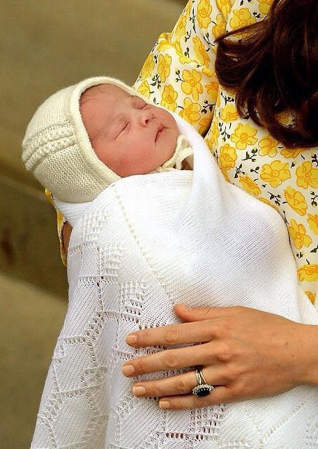 close-up of 10 hour old princess Cambridge looking pretty in Kate's arms