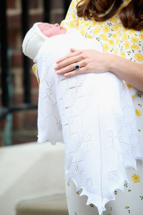 A close-up of the newborn princess, sleeping peacefully in Kate's arms