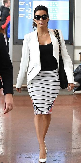 Eva Longoria mixes the stripes into a sophisticated look with her white blazer and kitten heels