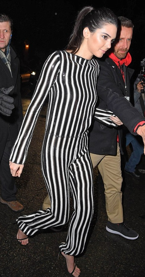 Kendall Jenner wears vertical striped jumpsuit and towring stilettos