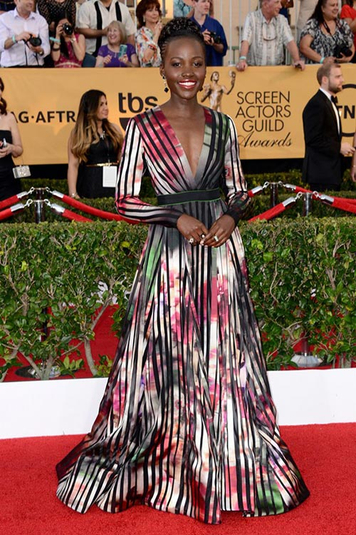 Lupita Nyongo in a striped flowery dress at the SAG Awards 2015