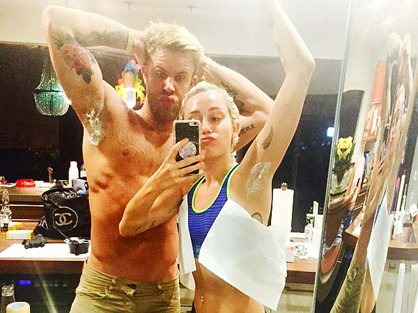 Miley Cyrus lets Justin Anderson color her armpit hair in pink