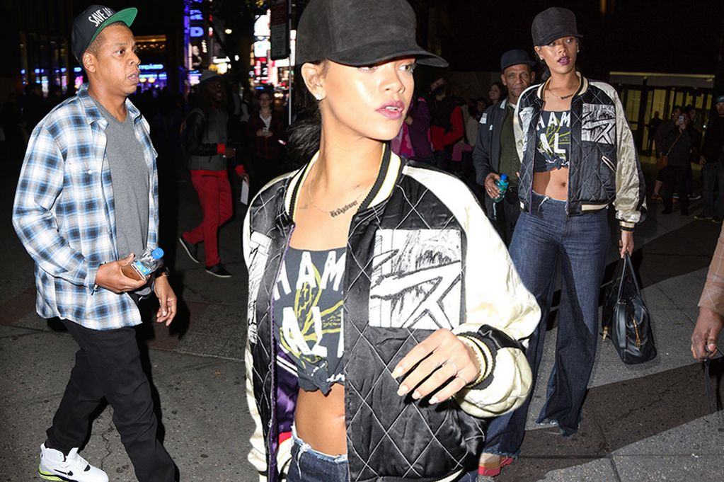 Rihanna flashes toned stomach in knotted t-shirt
