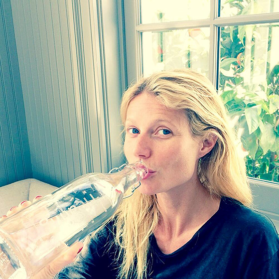 Gwyneth Paltrow hydrated her bare skin by downing a huge gulp of water