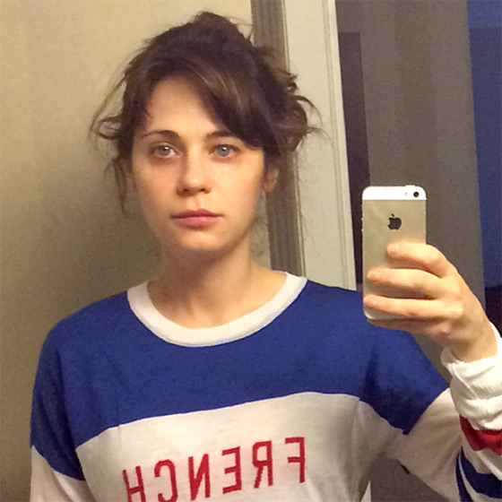 Zooey Deschanel selfied her sleepy eyes and messy hair in a nomakeup photo