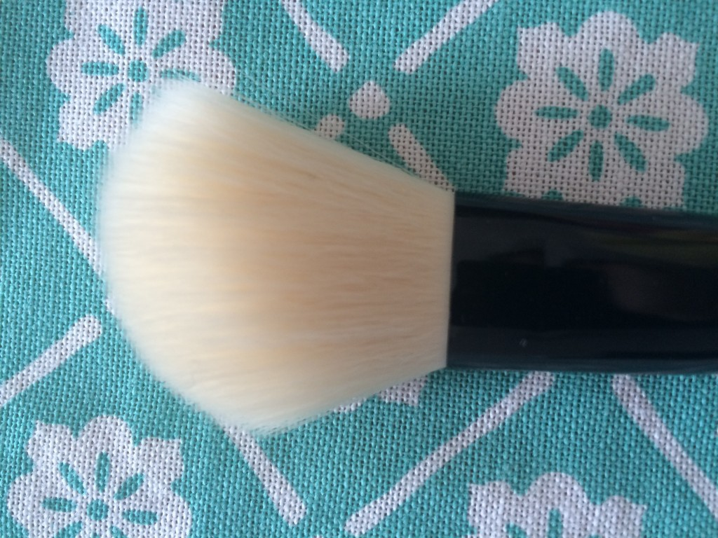 Angled Blush Brush: The slanted bristles help you apply tan powder products below your cheekbones to intensify your natural contours. It's best to use products two shades darker than your skin tone.