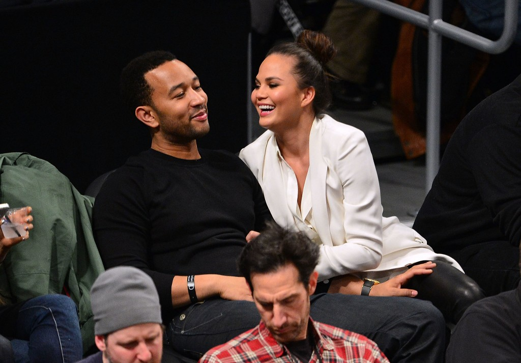 John Legend and Chrissy Teigen looking cute at the Lakers game